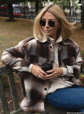 a person in sunglasses sitting in a chair talking on a cell phone: Meanwhile fashion blogger Emma Hill, from London, delighted followers when she shared a picture in the jacket