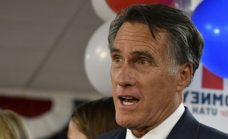 Mitt Romney wearing a suit and tie
