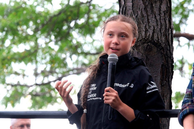 Slide 1 of 50: Greta Thunberg, a 16-year-old Swedish climate activist, speaks in front of a crowd of people after sailing in New York harbor aboard the Malizia II, Wednesday, Aug. 28, 2019. The zero-emissions yacht left Plymouth, England on Aug. 14. She is scheduled to address the United Nations Climate Action Summit on Sept. 23. (AP Photo/Mary Altaffer)