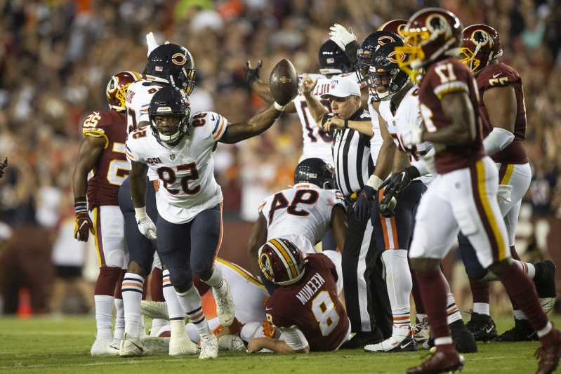 a group of football players on the field: Chicago Bears linebacker Danny Trevathan (59) recovers Washington Redskins quarterback Case Keenum (8) fumble in the first quarter at FedExField on September 23, 2019.