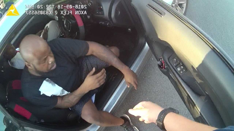 a man sitting in a car: Man sues LMPD claiming racial bias following traffic stop in west Louisville
