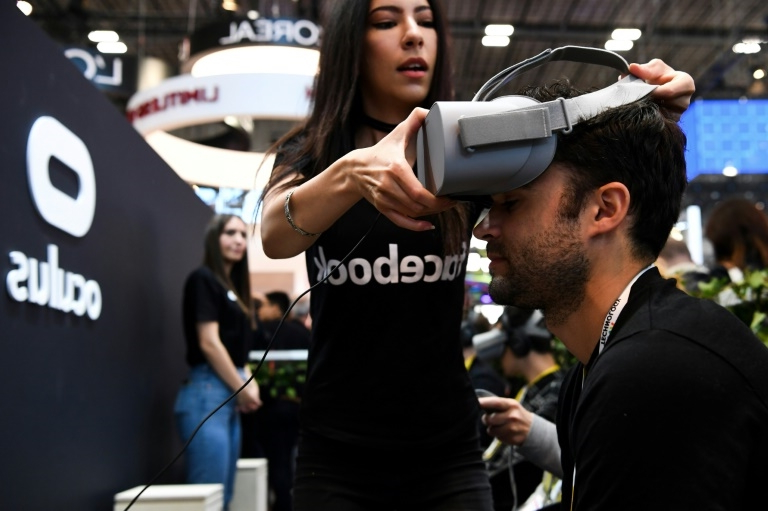 a person standing in front of a crowd: Facebook's acquisition of CTRL-labs comes after it bought Oculus in early 2014, whose Quest VR headset has pushed down the price of virtual reality gear