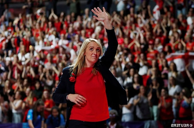 a person standing in front of a crowd: Tracey Neville, 42, (pictured in July) stepped down as England head coach after overseeing their third-place finish at the World Cup in July