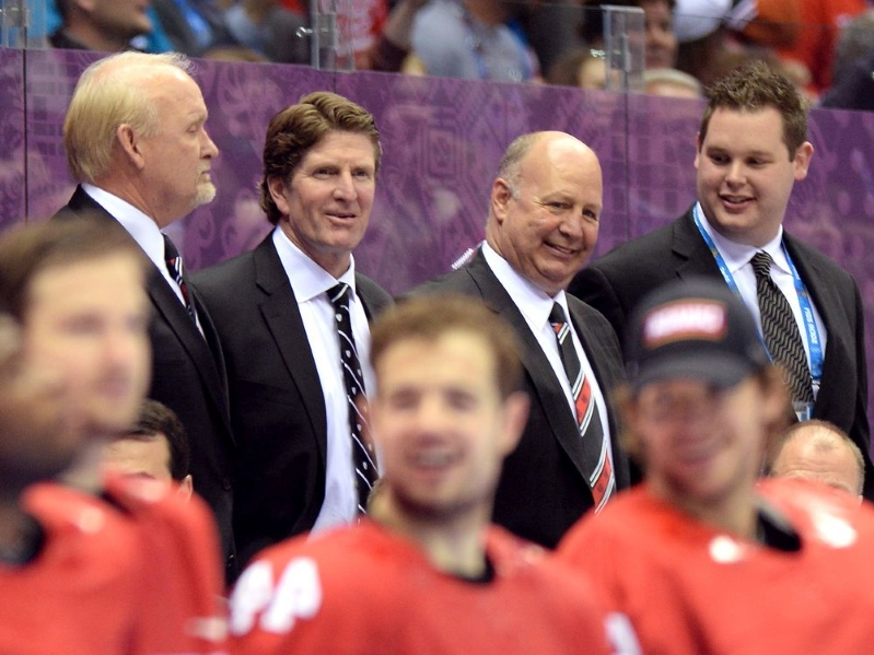 Claude Julien, Mike Babcock around each other:  Claude Julien (second from left) and head coach Mike Babcock look on during the medal ceremony after Team Canada defeated Sweden 3-0 during the Men's Ice Hockey Gold Medal match on Day 16 of the 2014 Sochi Winter Olympics at Bolshoy Ice Dome on February 23, 2014 in Sochi, Russia.