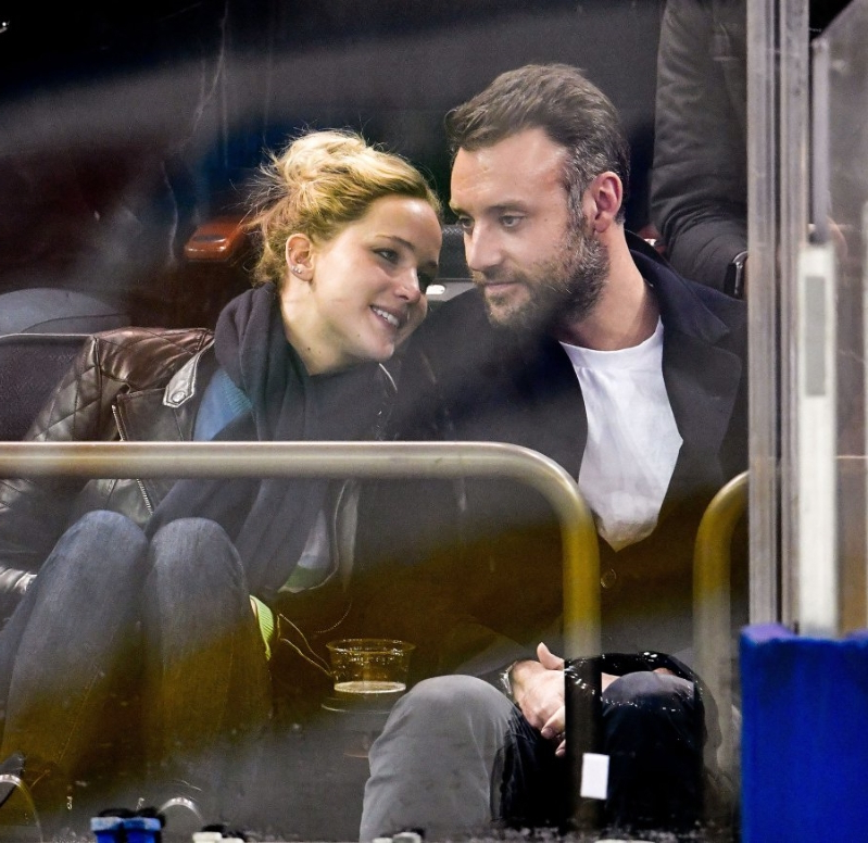 Cooke Maroney and Jennifer Lawrence watch the New York Rangers play against the Buffalo Sabres at Madison Square Garden on November 4, 2018 in New York City.