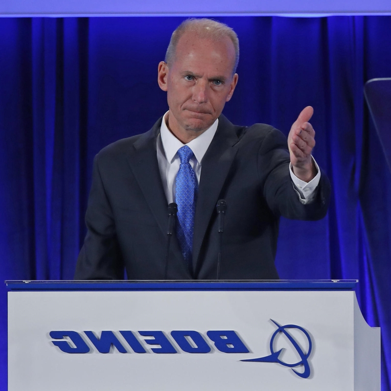 Dennis Muilenburg in a suit standing in front of a display screen: US-POLITICS-BUSINESS-TRUMP