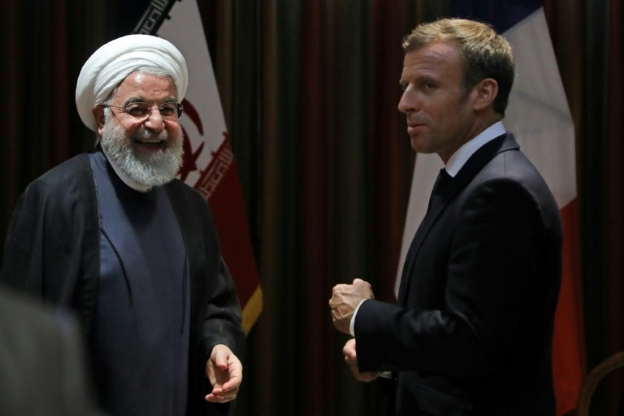 Emmanuel Macron, Hassan Rouhani are posing for a picture: French President Emmanuel Macron speaks with Iranian President Hassan Rouhani at the UN General Assembly