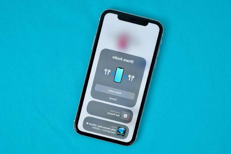 a close up of a device: Two pairs of AirPods, one audio source? No problem on iOS 13. Jason Cipriani/CNET