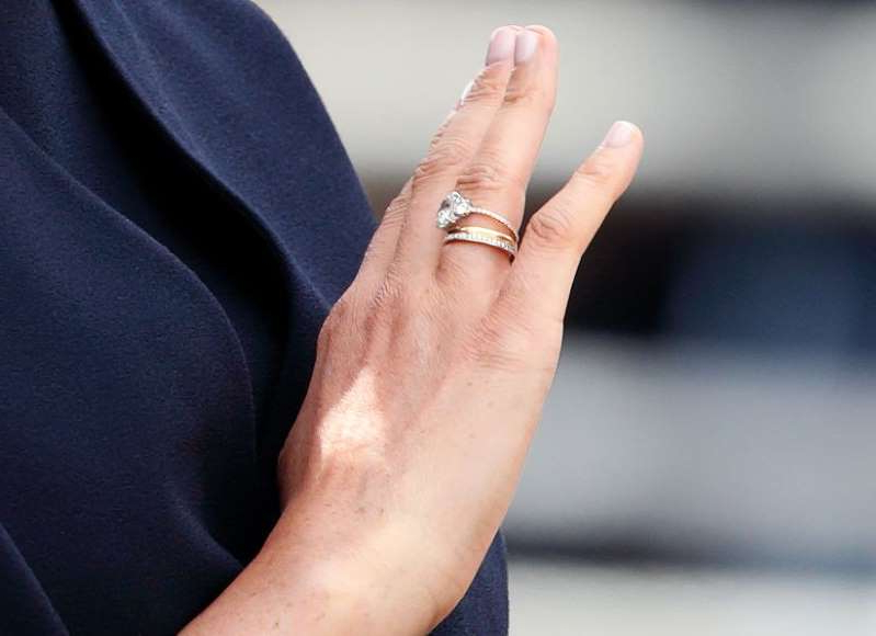 a close up of a hand: Meghan's recast ring during Trooping the Colour.