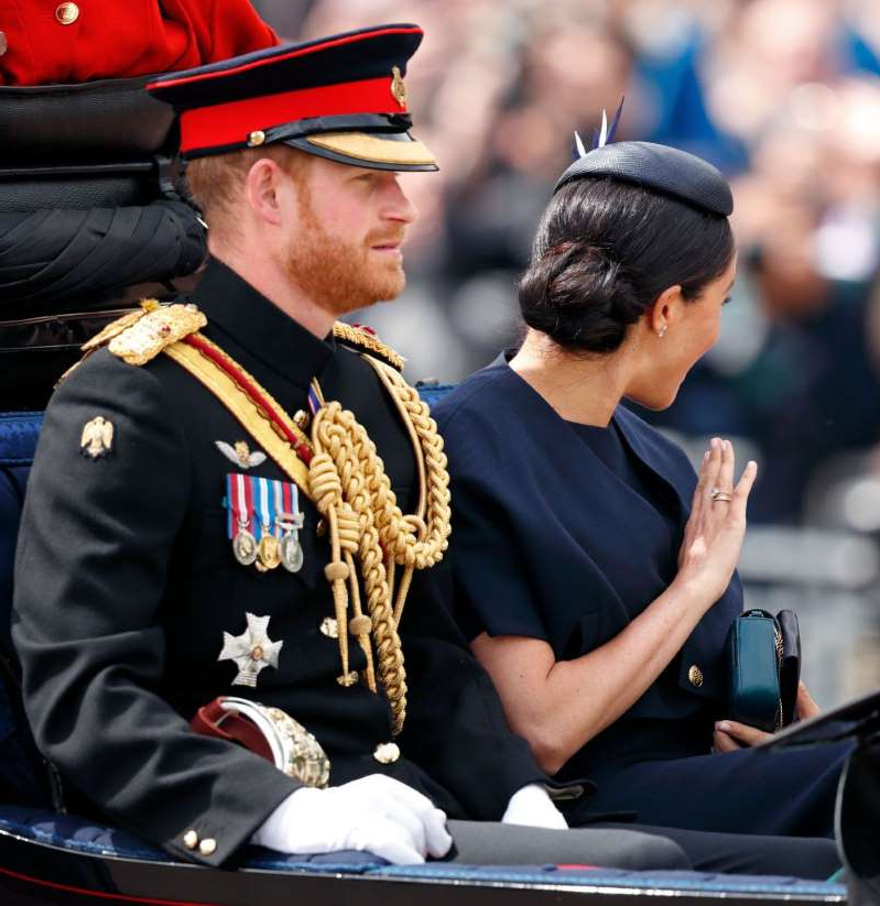 a man talking on a cell phone: Trooping The Colour 2019
