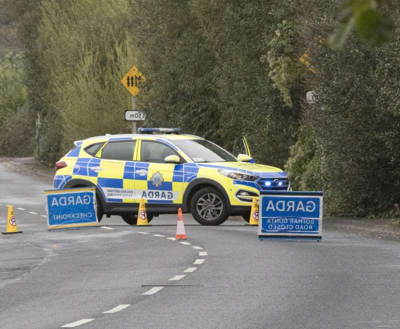 a police car parked on the side of a road: Scene of fatal car crash in Quinspool, Co Clare Photograph Liam Burke/Press 22