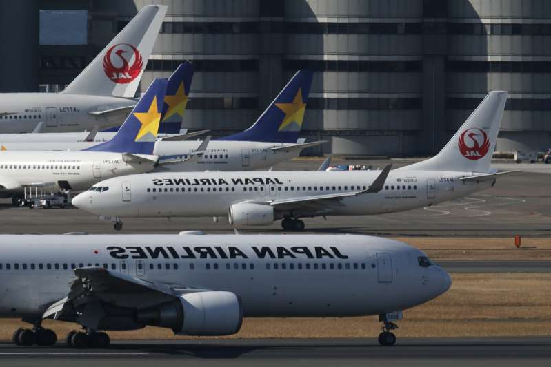 Civil jet airplanes of JAL - Japan Airlines and Skymark Airlines at Haneda International Airport, Tokyo, Japan. (Photo by: aviation-images.com/UIG via Getty Images)