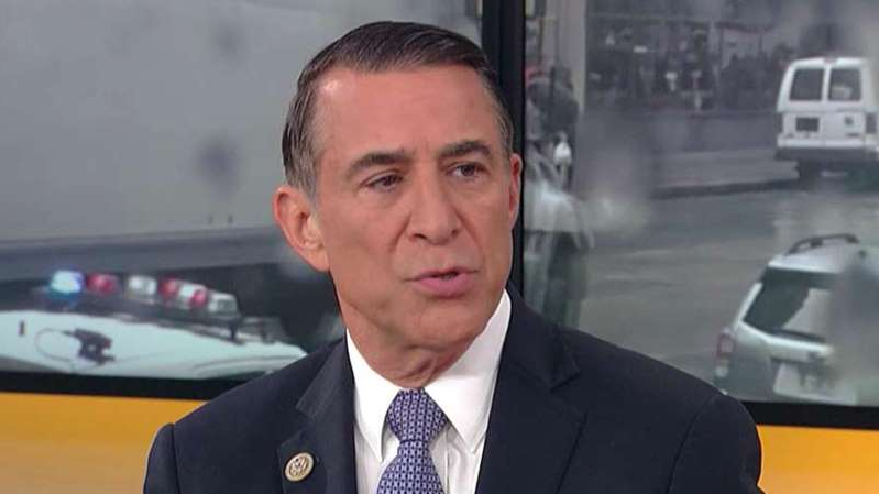 Darrell Issa wearing a suit and tie
