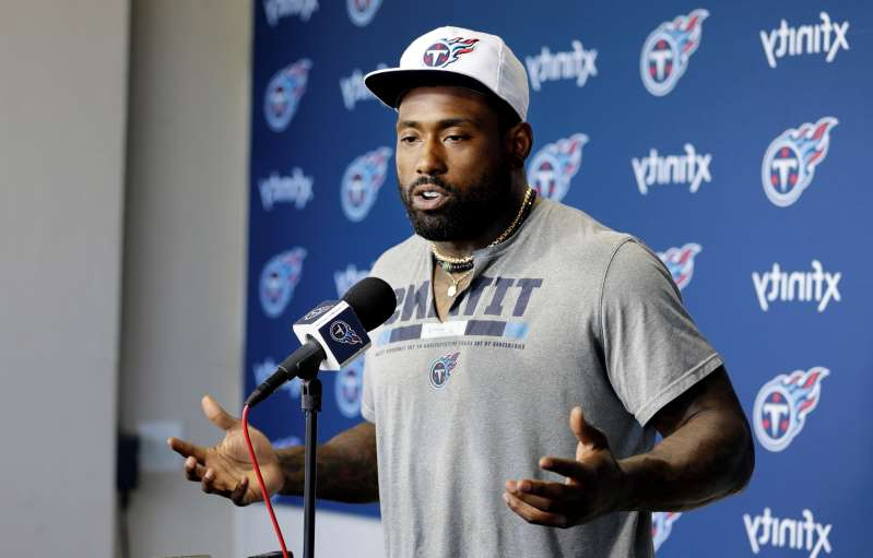 Delanie Walker holding a baseball bat: Tennessee Titans tight end Delanie Walker answers questions during a news conference Monday, April 15, 2019, in Nashville, Tenn. The Titans are trying to figure out how to improve after three straight 9-7 seasons as the team begins their offseason program. (AP Photo/Mark Humphrey)