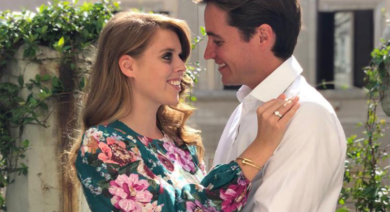 Princess Beatrice of York et al. eating a sandwich: Princess Beatrice wore a Zimmerman dress to announce her engagement [Photo: PA]