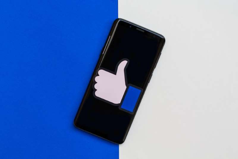 a drawing of a face: Facebook will begin testing hiding the number of likes, reactions and views posts get. Angela Lang/CNET