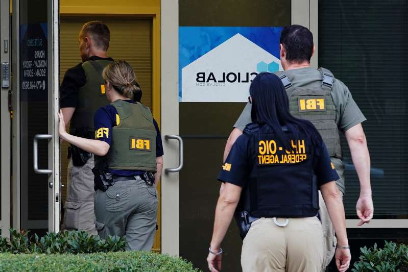 Federal agents execute a search warrant on Clio Laboratories in Lawrenceville, Ga., on Sept. 27, 2019.