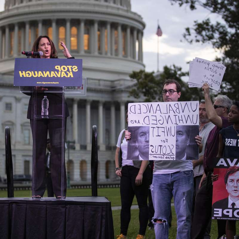 Kamala Harris et al. standing in front of a building: Senators Review FBI Report Ahead Of Vote On Kavanaugh Supreme Court Nomination