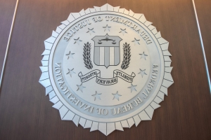 FBI arrests former state trooper accused of money laundering, falsifying government documents