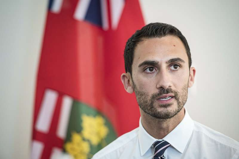 a man wearing a suit and tie smiling at the camera: Ontario Minister of Education Stephen Lecce speaks to teachers before giving remarks, in Toronto, on Thursday, August 22, 2019.