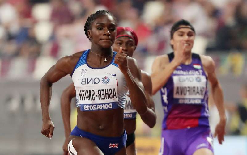 Dina Asher-Smith standing in front of a crowd: World Athletics Championships - Doha 2019