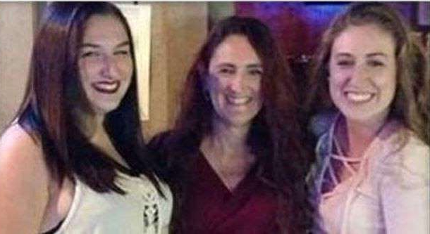 a group of people posing for the camera: Suzanne Taylor, 45, and her two daughters, Taylor Pifer, 21, and Kylie Pifer, 18, were murdered inside their North Royalton home in June 2017.