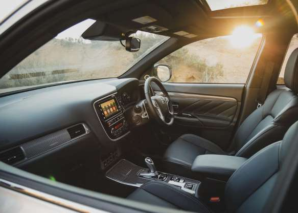 a view of a car: The Outlander's cabin is a spacious and comfortable place to be.