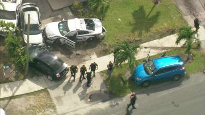 a man driving a car: Police pursuit ends in crash in Pompano Beach on Oct. 2, 2019. (CBS4)