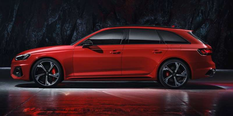 a red car parked on the side of a road: The European wagon gets a new look but keeps the 444-hp V-6 that we know from the RS5.