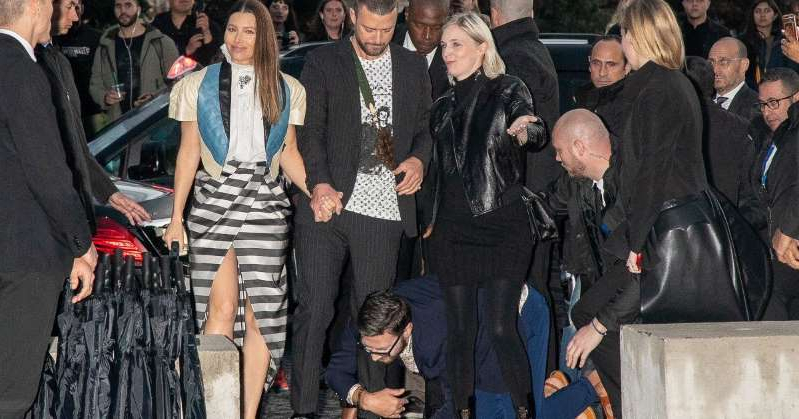 Jessica Biel et al. posing for the camera: Justin Timberlake Grabbed by Notorious Prankster While Walking into Paris Event with Jessica Biel