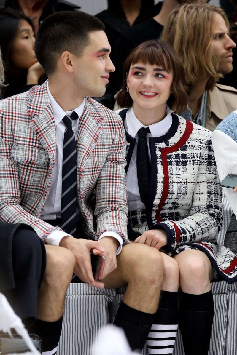 Maisie Williams et al. posing for the camera: Thom Browne : Front Row - Paris Fashion Week - Womenswear Spring Summer 2020