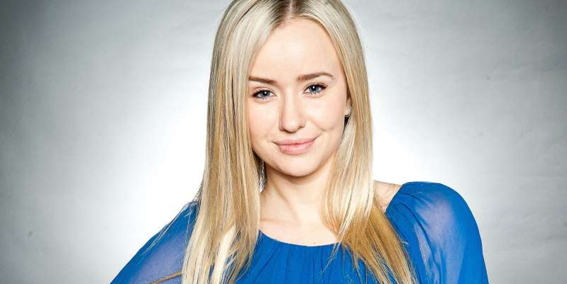 Sammy Winward wearing a blue shirt: Emmerdale's Sammy Winward says that she was approached over a return as Katie Sugden – as a ghost.