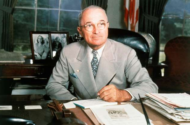 Slide 11 of 13: This 1948 portrait of Harry S. Truman at his White House office desk. (AP Photo)