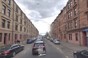 Two rushed to hospital after blaze rips through Glasgow tenement