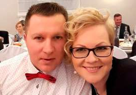 a person wearing glasses and smiling at the camera: Frenzied attack: Mikolaj Wilk pictured with his wife Elzbieta