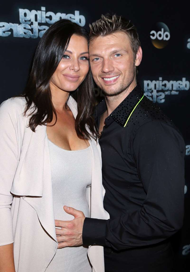 Nick Carter et al. posing for a picture: Nick Carter (L) and wife Lauren