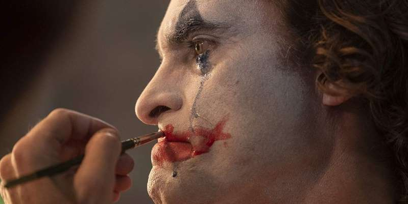 a person brushing the teeth with a toothbrush in the mouth: In 'Joker', Joaquin Phoenix plays Arthur Fleck, a man with pseudobulbar affect, a real medical condition that causes uncontrollable outbursts of laughter.