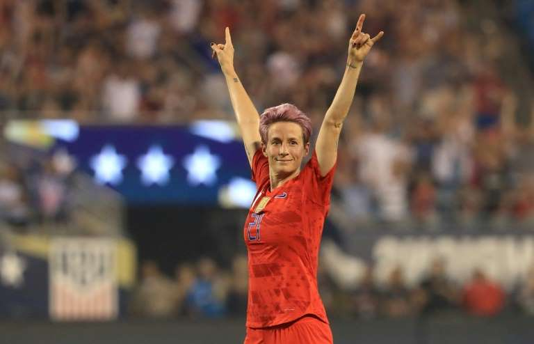 a person throwing a ball: Megan Rapinoe reacts after a goal by teammate Allie Long in the United States' 2-0 friendly football win over South Korea in Charlotte, North Carolina