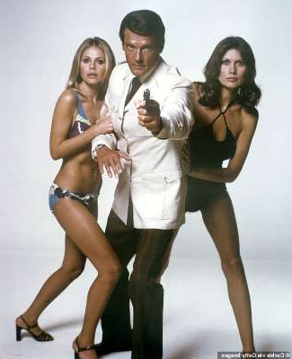 Maud Adams, Roger Moore, Britt Ekland posing for the camera: Iconic: The legendary actor, who passed away in 2017 aged 89, played notorious lothario Bond on seven highly entertaining occasions over a 12-year period
