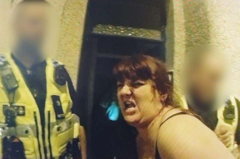 a woman standing in front of a mirror posing for the camera: Tanya Palmer screamed expletives at officers