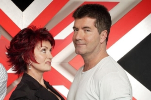 Simon Cowell ENDS his feud with nemesis Sharon Osbourne over the phone as he claims he'd 'never criticize her for being mouthy'