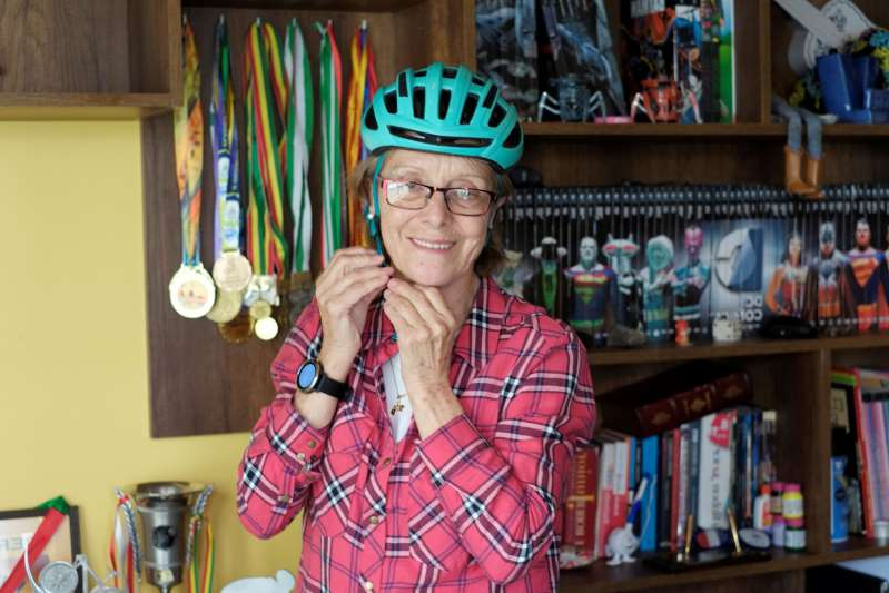 a little girl standing in a room: Mirtha Munoz a 70-year-old runner participates in the Sky Race, Bolivia's toughest cycling competition