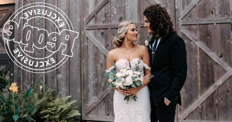 a person standing in front of a building: American Idol's Gabby Barrett and Cade Foehner Are Married! All the Details From Their Wedding