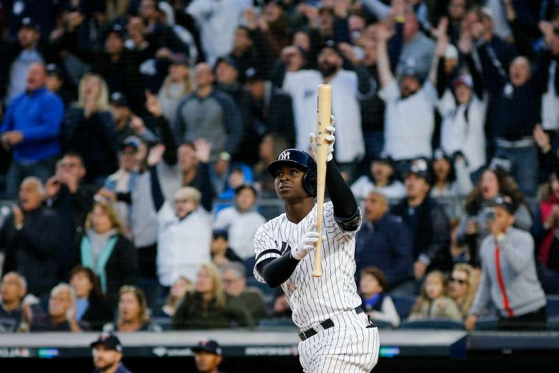 Didi Gregorius standing in front of a crowd