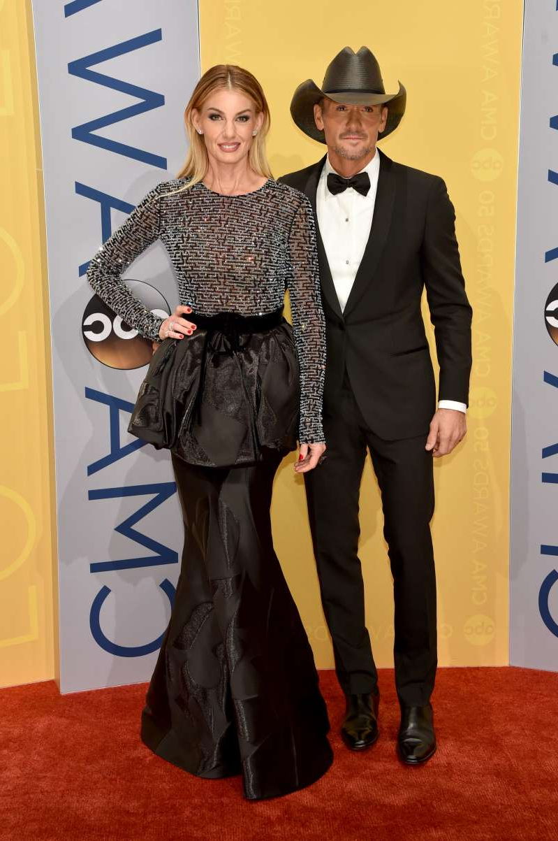Tim McGraw, Faith Hill are posing for a picture: Tim McGraw and Faith Hill attend the 50th annual CMA Awards at the Bridgestone Arena in Nashville, Tenn., on Nov. 2, 2016.