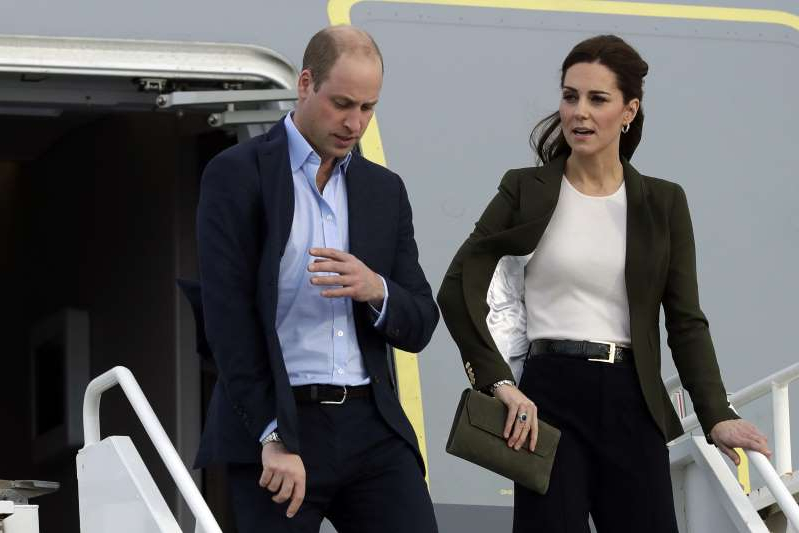 Britain's Prince William and his wife Kate, the Duchess of Cambridge, arrive at the Akrotiri Royal Air Force base, near the south coastal city of Limassol, Cyprus