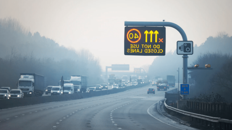 a highway sign sitting on the side of a road: Rex X smart motorways