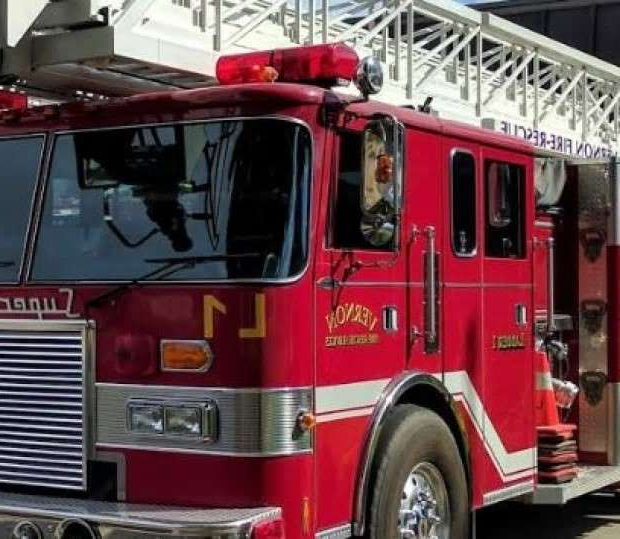 a large red fire truck parked in front of a building: A B.C. arbitration board ordered the City of Vernon to reinstate two employees who were fired after they were caught on camera engaging in a sexual act in the fire chief's office.