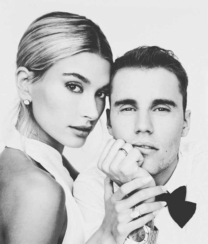 a man and woman posing for a photo: Justin Bieber and Hailey Bieber on their wedding day.
