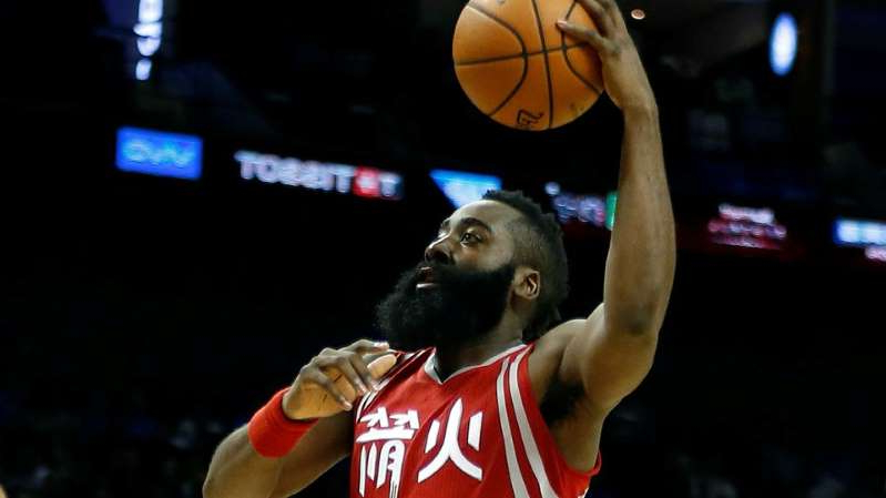 a man holding a basketball: James Harden of the Houston Rockets
